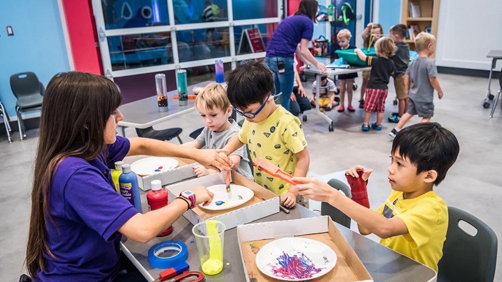 Children participating in art project in KidsTown studio