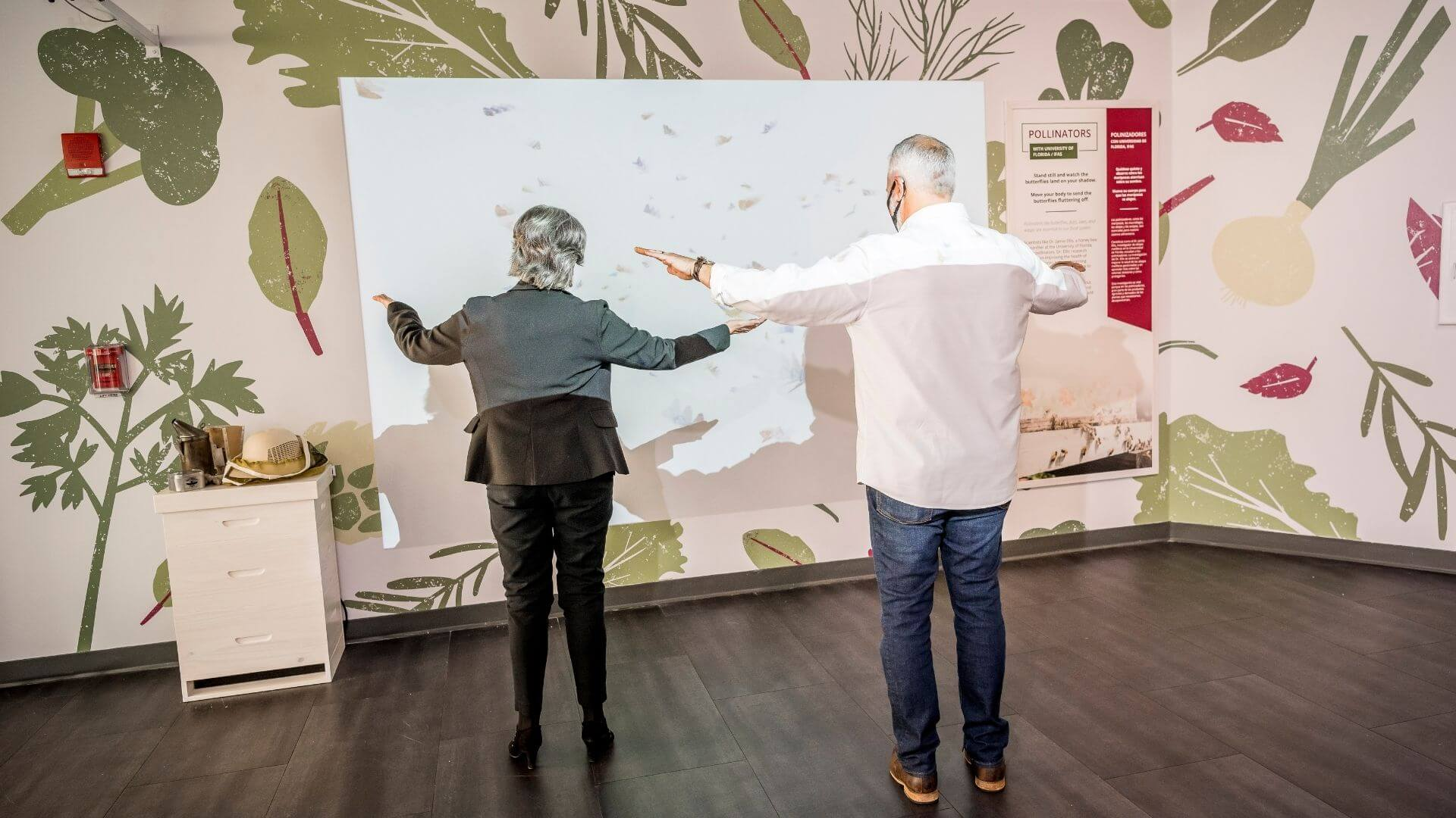 two people interacting with an augmented reality screen