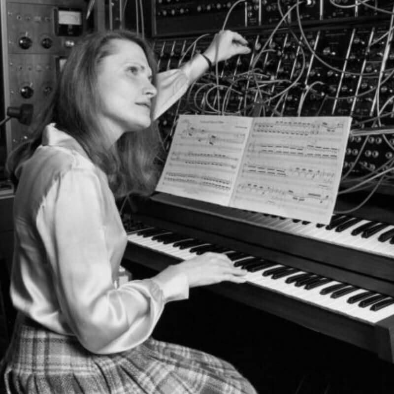 Wendy Carlos by a piano