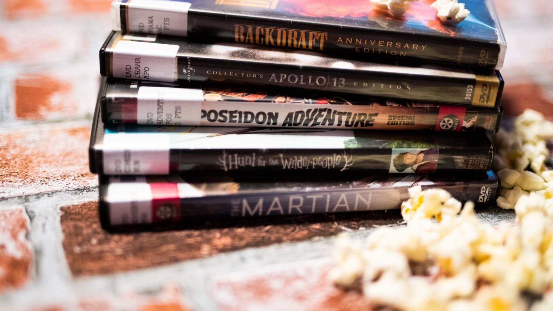 a stack of movies and popcorn