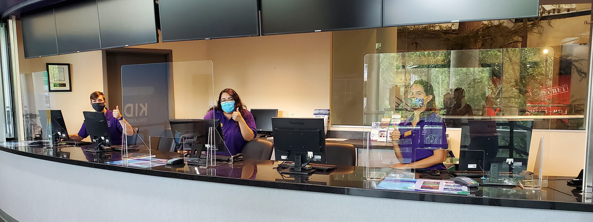 Image of OSC Admissions team in box office behind new plexiglass barriers.