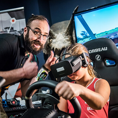 Girl experiences Virtual Reality Driving game