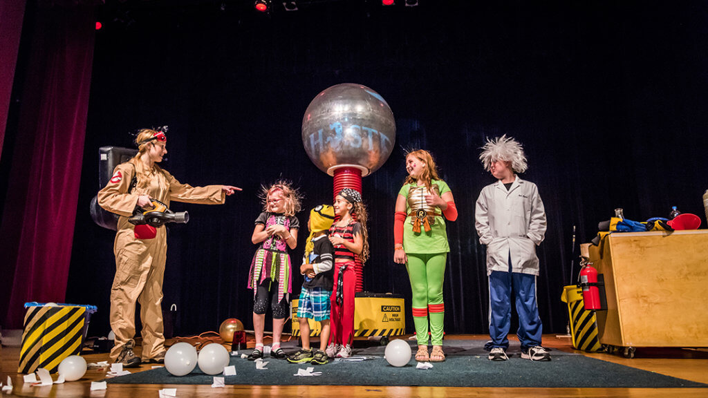 Five kids participating on stage in Ghostflusters Live Show.