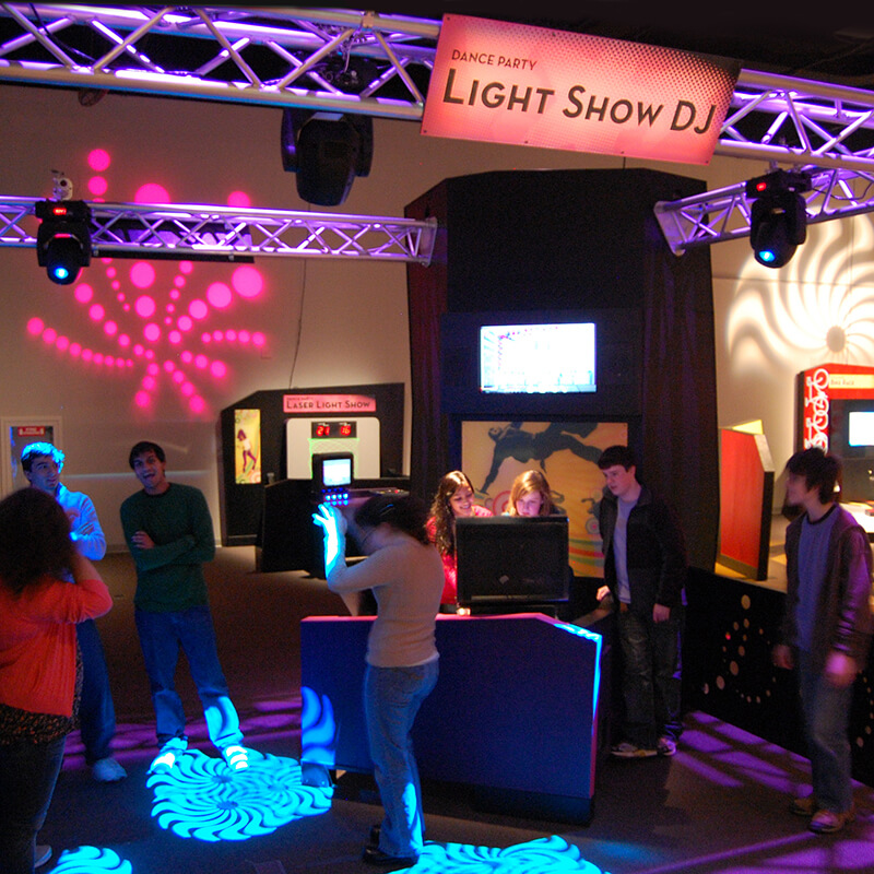 Guests dancing to music and a light show