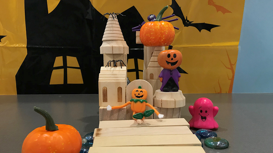 Image of a Tinker Time Monster Mansion made from blocks and happy Halloween toys.